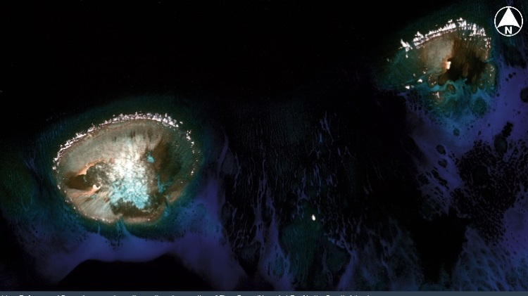The northeastern portion of Fiery Cross (Yongshu) Reef in the Spratly Islands shows no sign of land reclamation from March 2013 to April 2014. (PLEIADES CNES 2013, Distribution Airbus DS / Spot Image / IHS)