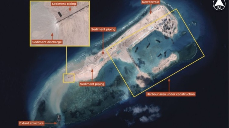 Satellite  imagery dated 14 November 2014 shows the island has expanded almost the entire length of the reef. It is reportedly 3000 m long and between 200 and 300 m wide. According IHS Jane's report, multiple operating dredgers provide the ability to generate terrain rapidly. Operating from a harbour area, dredgers deliver sediment via a network of piping. (© CNES 2014, Distribution Airbus DS / Spot Image / IHS)